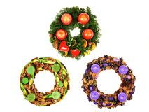 Three Christmas wreaths. Three Beautiful Advent Christmas wreaths with candles Royalty Free Stock Photo