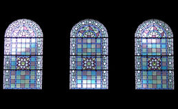 Three church windows. Window detail from inside with glass in different colors royalty free stock photo