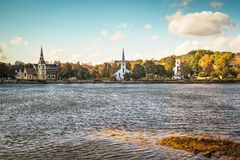 Three Churches of Mahone Bay. Three churches line the bank of Mahone Bay in Nova scotia, Canada stock photos