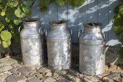 Three churns on a farm Stock Photography
