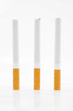 Three cigarettes Stock Photos