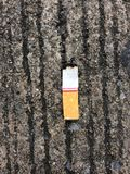 Three cigarettes butts on the ground Royalty Free Stock Photography