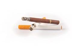 Three Cigarettes on White Background Royalty Free Stock Photos