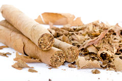 Three cigars and tobacco Stock Photo