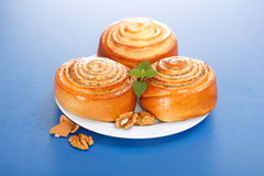 Three cinnamon rolls on plate Stock Photo