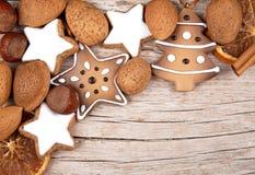 Three cinnamon stars with other christmas decoration Stock Photos