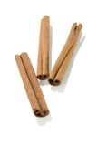 Three Cinnamon Sticks Stock Photography