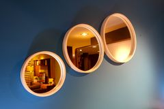 Three circle shaped mirrors side by side on the wall Royalty Free Stock Photo