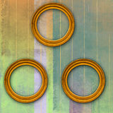 Three circular golden frames on grunge texture. Abstract and geometric background with three antique circular golden frames vector illustration