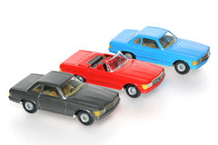Three Classic Mercedes toy cars. One of the many thousand  toys my brother is collecting. Tin Mercedes Royalty Free Stock Images