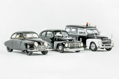 Three classic vintage miniature cars, one police car, Scale models. Stockholm, Sweden - August 17, 2017: Close up studio shot of three isolated Swedish classic stock photos