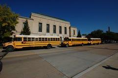 School buses in Ann Arbor, Michigan USA. Three classic yellow school buses in convoy, Ann Arbor Michigan USA Stock Photos