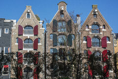 Three classical holland houses with shutters on the street in the day Stock Photography