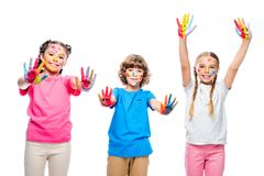 three classmates having fun and showing painted hands with smiley icons stock photos