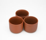 three clay cup isolated on white Royalty Free Stock Photos