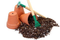 Three Clay Pots, Soil and Tools Royalty Free Stock Photography