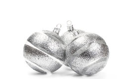 Three clear christmas balls with glitter stripes Royalty Free Stock Photo
