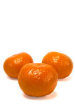 Three clementines. Isolated against a white background Stock Image