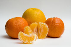 Three clementines and one orange Stock Image