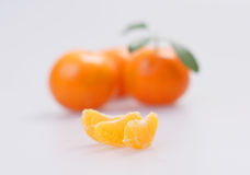 Three clementines with segments Royalty Free Stock Images