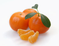 Three clementines with segments Royalty Free Stock Photography