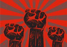 Three clenched raised fists. Three clenched fists raised in protest on grunge background with sun rays. Retro style poster. Protest, strength, freedom Stock Photography