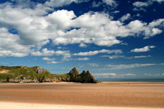 Three cliff bay. In the Gower peninsula, low tide stock image