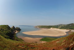 Three Cliffs Bay, Gower. A  fisheye view of Three Cliffs Bay, on The Gower Peninsular, South Wales - taken early one morning in July Stock Photography