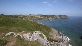 Three Cliffs Bay Gower Peninsula Wales uk PAN from West stock video footage