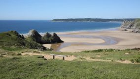 Three Cliffs Bay south coast the Gower Peninsula Swansea Wales uk. Near to Oxwich stock video footage