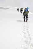 Three climbers ascend the glacier. To the top of the mountain Titnuld Stock Image