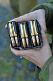 Three clips of 7,62x51 ammo. Three clips of Nato ammunition held by female soldier Stock Images