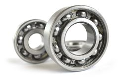Bearings. Three close-up bearings on the white background royalty free stock images