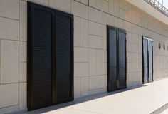Three closed black doors Stock Photos