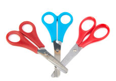 Three closed blue and red scissors for kids on a Stock Photography