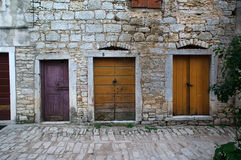 Three closed doors in the old town Royalty Free Stock Image