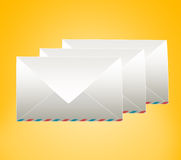 Three closed envelope. On a yellow background Stock Images