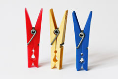 Three cloth pegs Royalty Free Stock Image
