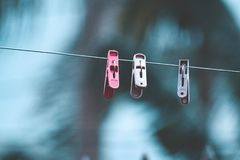Three Clothespins on Clothesline royalty free stock photos