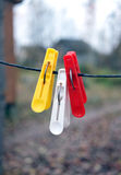 Three clothespins hanging on a rope Stock Image