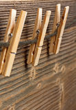 Three clothespins on rope Royalty Free Stock Photography