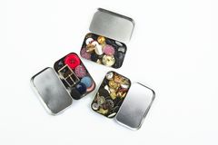 Three clothing buttons metal boxes collection Royalty Free Stock Images