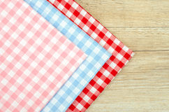 Three cloths with checks on a table Stock Photography