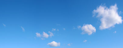 Three clouds in the blue sky Royalty Free Stock Images