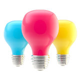 Three CMYK colored bulbs Royalty Free Stock Photo