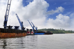 Three coal barge was unloading cargo at the port Royalty Free Stock Photo