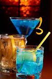 Three cocktails. Orange blurred background royalty free stock images