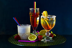 Three cocktails on a bar Stock Images