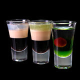 Three cocktails layered shots isolated stock photos