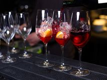 Three cocktails with orange wine and ice on the bar in the restaurant stock photo